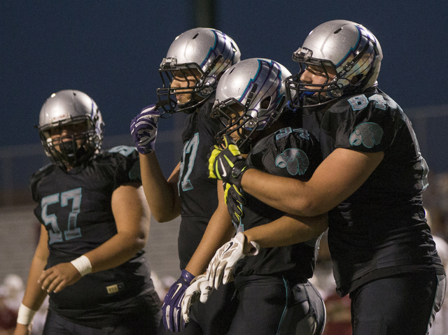 Silverado running back Keikiokalani Misipeka (34) celebrates with teammates after scoring a first quarter touchdown during the Skyhawks home matchup with the Faith Lutheran Crusaders on Friday, Se ...