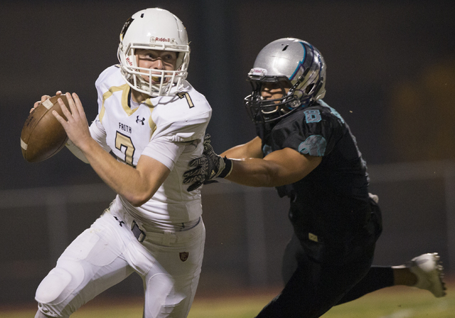 Faith Lutheran quarterback Sagan Gronauer (7) scrambles away from Silverado strong safety Pekelo Solomon (8) during the Crusaders road matchup with the Skyhawks on Friday, Sept. 16, 2016, at Silve ...