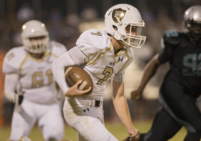 Faith Lutheran quarterback Sagan Gronauer (7) scrambles down the sideline during the Crusaders road matchup with the Skyhawks on Friday, Sept. 16, 2016, at Silverado High School, in Las Vegas. Ben ...