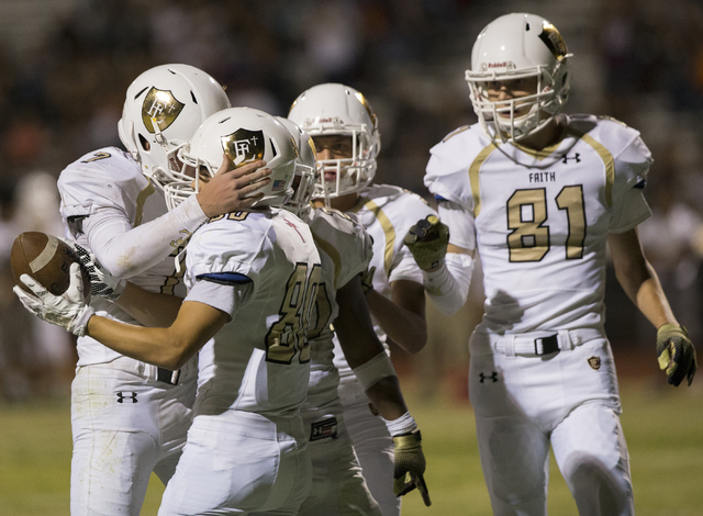 Faith Lutheran wide receiver Eric Ho (80) celebrates with teammates after scoring a second quarter touchdown during the Crusaders road matchup with the Skyhawks on Friday, Sept. 16, 2016, at Silve ...
