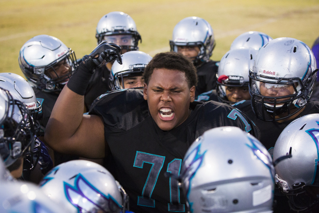 Silverado lineman Ryan Scoggins (71) fires up his teammates before the start of the Skyhawks home matchup with the Faith Lutheran Crusaders on Friday, Sept. 16, 2016, at Silverado High School, in  ...