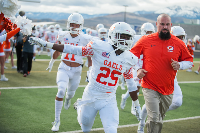 Bishop Gorman's Tyjon Lindsey (25) laughs while entering the field against Reed before the first half of Saturday's Division I championship game in Reno. Lindsey caught four passes for 122 yards a ...