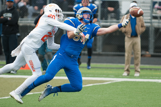 Reed's Parker Houston (84) reaches for a pass against Bishop Gorman's Jabari Butler (20) during the first half of the Division I Championship game at Damonte Ranch on Saturday. Houston caught four ...