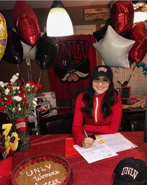 Spring Valley's Jozee DeCunzo signs her letter of intent to play soccer at UNLV. (Courtesy photo)