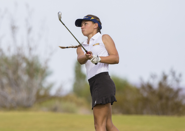Boulder City golfer Lani Potter hits an iron shot during the Eagles match with Coronado on Monday, Sept. 19, 2016, at Boulder Creek Golf Course, in Boulder City. Benjamin Hager/Las Vegas Review-Jo ...