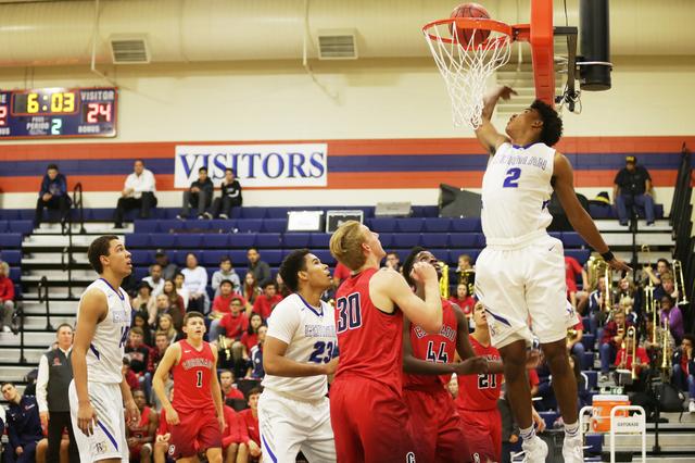 Bishop Gorman's  shooting guard Jamal Bey (2) takes a shot against Coronado during a basketball game at Bishop Gorman High School on Tuesday, Dec. 6, 2016, in Las Vegas. (Rachel Aston/Las Vegas Re ...