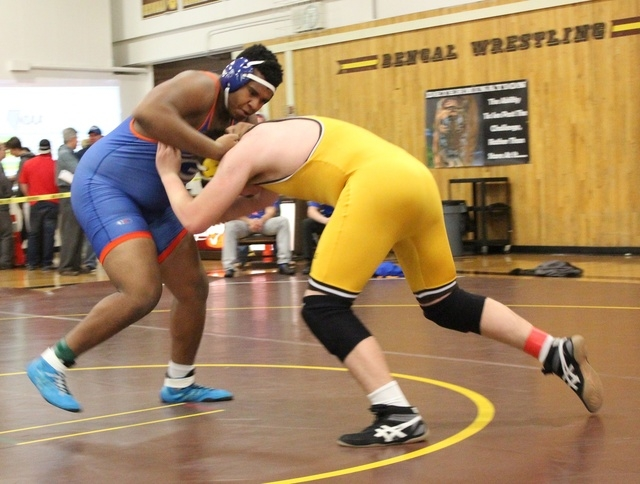 Bishop Gorman senior Jackson Perry, who signed a letter-of-intent to play football for Dartmouth on Wednesday, defeated Bonanza's Tyler Weinand with a pin at the 59-second mark to move into Saturd ...