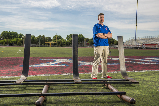 Valley High School football coach George Baker poses for a photo on the football field at Valley High School in Las Vegas on Wednesday, May 4, 2016. Baker is using social media to raise money for  ...