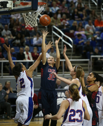 Liberty's Jazmin O'Bannon shoots through a crowd of Reno defenders during the Division I championship game in the NIAA basketball state tournament at Lawlor Events Center, in Reno, Nev., on Friday ...