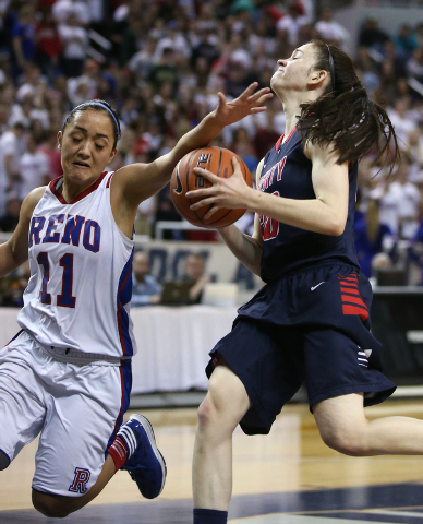 Reno's Daranda Hickey fouls Liberty's Kealy Brown during the Division I championship game in the NIAA basketball state tournament at Lawlor Events Center, in Reno, Nev., on Friday, Feb. 28, 2014.  ...