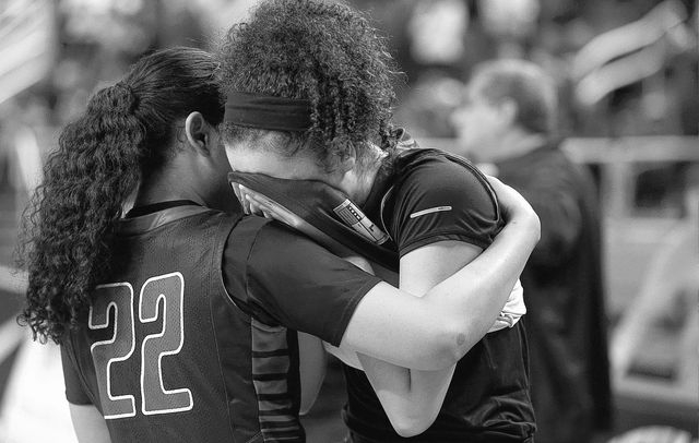 Liberty Patriots Ahlia Tai and Jazmin O'Bannon console each other on the sidelines after losing 50-39 to the Reno Huskies in the Division I title game in the NIAA basketball state tournament at La ...