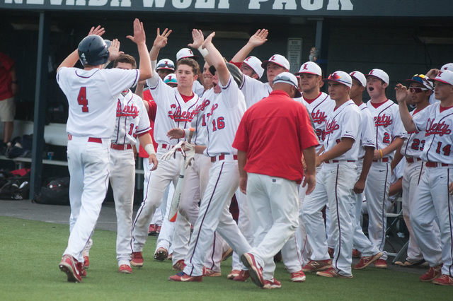 The Liberty bench comes out to greet Jay Martz after scoring the tying run against Centennial in the Division I state tournament on Friday. Martz scored the tying run in the sixth, then singled ho ...
