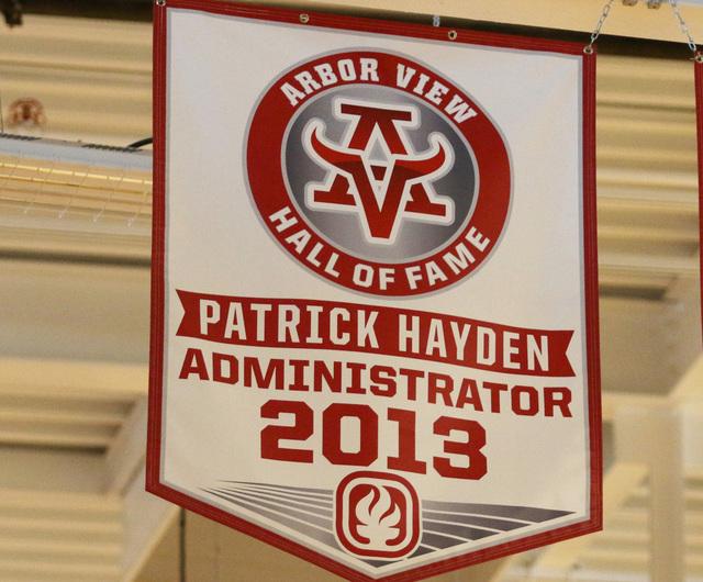 A banner honoring former principal Pat Hayden, at left, hangs in Arbor High School's Athletic Hall of Fame in the gymnasium at Arbor View High School Wednesday, June 17, 2015, in Las Vegas. Hayden ...