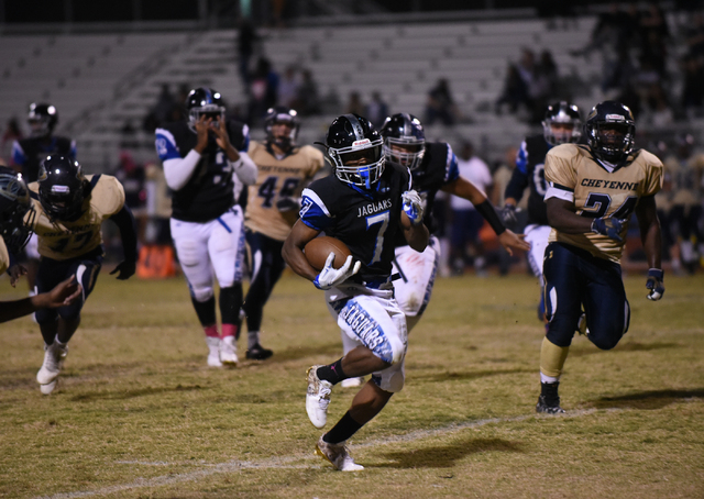 Desert Pines Isaiah Morris (7) runs down field against the Cheyenne defense during their football game played at Desert Pines field in Las Vegas on Friday, Oct. 7, 2016. Desert Pines defeated Chey ...