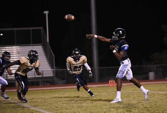 Desert Pines Randal Grimes (9) throws the ball against the Cheyenne defense during their football game played at Desert Pines field in Las Vegas on Friday, Oct. 7, 2016. Desert Pines defeated Chey ...