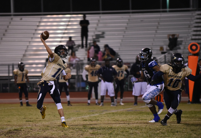 Cheyenne's Matthew LaBonte (12) throws the ball against Desert Pines defense during their football game played at Desert Pines field in Las Vegas on Friday, Oct. 7, 2016. Desert Pines defeated Che ...