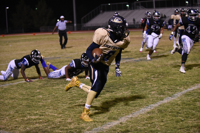 Cheyenne's Corwin Bush (6) runs the ball against Desert Pines defense during their football game played at Desert Pines field in Las Vegas on Friday, Oct. 7, 2016. Desert Pines defeated Cheyenne 3 ...
