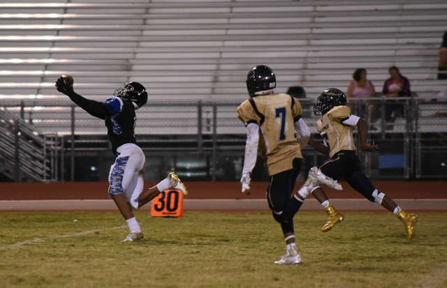 Desert Pines Tony Fields (1) catches the ball against Cheyenne's defense during their football game played at Desert Pines field in Las Vegas on Friday, Oct. 7, 2016. Desert Pines defeated Cheyenn ...