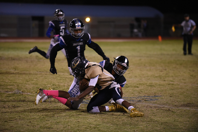 Cheyenne's Deriontae Green (5) is tackled by the Desert Pines defense during their football game played at Desert Pines field in Las Vegas on Friday, Oct. 7, 2016. Desert Pines defeated Cheyenne 3 ...