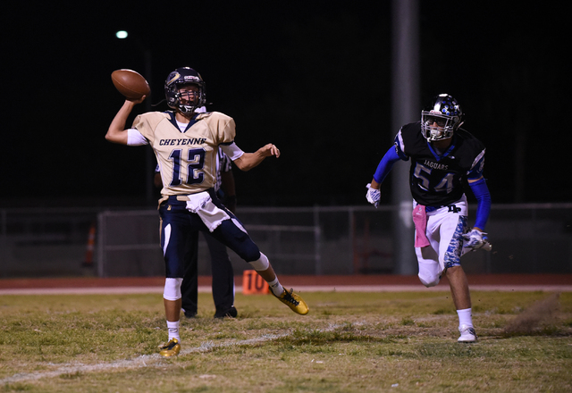 Cheyenne's Matthew LaBonte (12) throws the ball against Desert Pines Gabriel Lopez (54) during their football game played at Desert Pines field in Las Vegas on Friday, Oct. 7, 2016. Desert Pines d ...