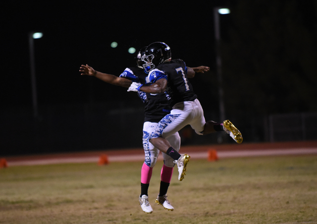 Desert Pines Isaiah Morris (7) celebrates after scoring a touchdown against the Cheyenne defense with teammate Christopher Wright (33) during their football game played at Desert Pines field in La ...