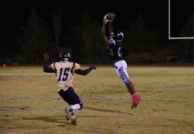 Desert Pines Jordan Simon (12) catches the ball against Cheyenne's Anthony Walker (15) during their football game played at Desert Pines field in Las Vegas on Friday, Oct. 7, 2016. Desert Pines de ...