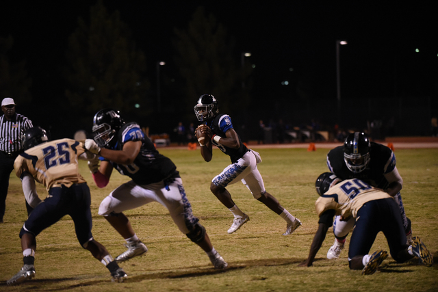 Desert Pines Randal Grimes (9) runs the ball against the Cheyenne defense during their football game played at Desert Pines field in Las Vegas on Friday, Oct. 7, 2016. Desert Pines defeated Cheyen ...