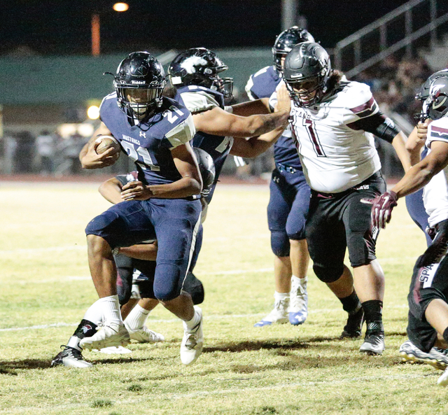 Shadow Ridge junior Kaejin Smith-bejgrowicz (21) runs the ball in for a two point conversion during a football matchup against  the Cimarron-Memorial Spartans at Shadow Ridge High School in Las Ve ...