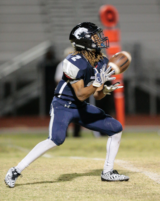Shadow Ridge junior Elisha Young (2) prepares to catch a kicked ball from Cimarron-Memorial during a football matchup held at Shadow Ridge High School in Las Vegas, Friday, Oct. 7, 2016. Donavon L ...