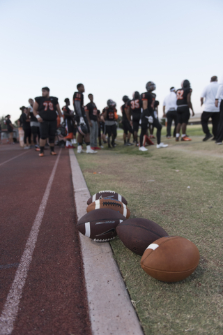 "Footballs sit on the side line near Chaparral prior to Eldorado playing the annual ""Cleat Game"" at Chaparral in Las Vegas, Friday, Sept. 9, 2016. Jason Ogulnik/Las Vegas Review-Journal"