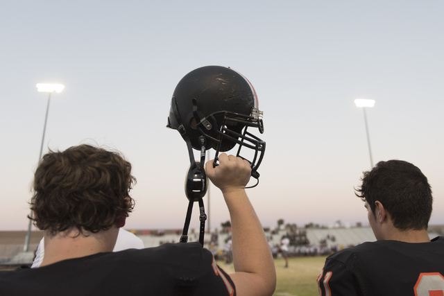 A Chaparral football team member raises their helmet prior to a game against Eldorado at Chaparral in Las Vegas, Friday, Sept. 9, 2016. Jason Ogulnik/Las Vegas Review-Journal