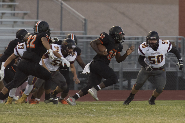 Chaparral's Trayvius Hodge (32) runs with the ball during a football game against Eldorado at Chaparral in Las Vegas, Friday, Sept. 9, 2016. Jason Ogulnik/Las Vegas Review-Journal