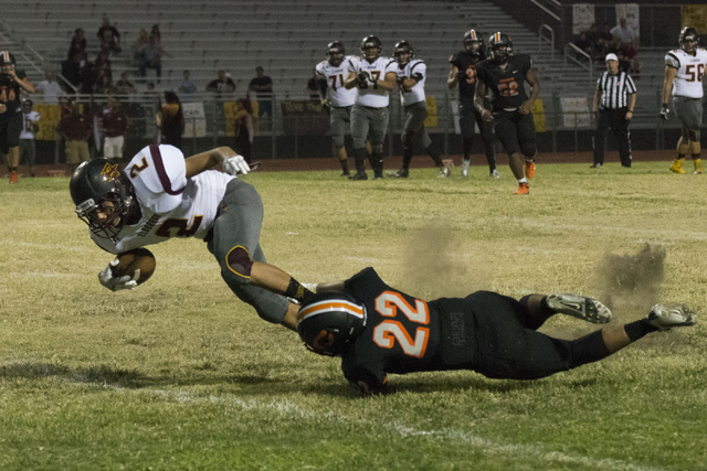 Eldorado's Andres Jimenez (2) is tackled as he runs with the ball during a football game at Chaparral in Las Vegas, Friday, Sept. 9, 2016. Jason Ogulnik/Las Vegas Review-Journal