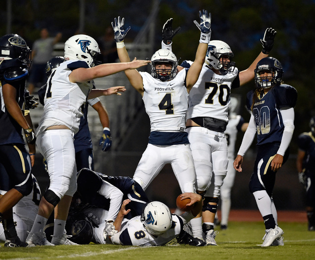 Foothill's Jared Ables (4) celebrates a touchdown after Blake Wilson (8) crosses the goal line against Cheyenne during a high school football game at Cheyenne High School in Las Vegas, Friday, Aug ...