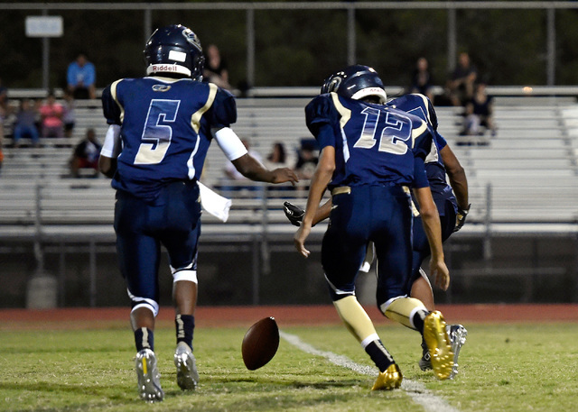 Cheyenne's Derionte Green (5) and quarterback Matthew LaBonte race to grab a fumble during a high school football game against Foothilll at Cheyenne High School in Las Vegas, Friday, Aug. 26, 2016 ...