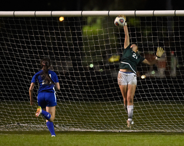 Palo Verde goalkeeper Kailee Barnhard blocks a shot from Reno's Shelby Clayton during a girls state soccer semifinal game at the Bettye Wilson Soccer Complex Friday, Nov. 11, 2016, in Las Vegas. P ...