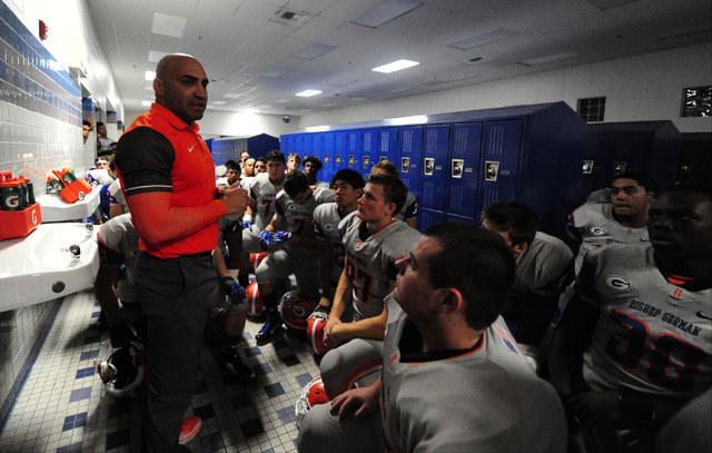 Bishop Gorman head coach Kenny Sanchez addresses his team before the start of their prep football game against Sierra Vista at Sierra Vista High School in Las Vegas Friday, Nov. 4, 2016. Josh Holm ...