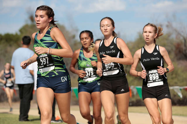 Green Valley's cross country runner Mia Smith (597) leads a small group of runners in the varsity A girls race during the 2016 Larry Burgess Cross Country Invitational held at Sunset Park, 2601 Ea ...