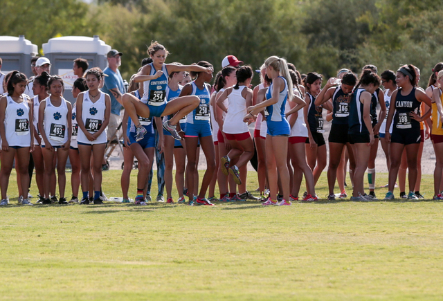 Cross country varsity girl runners warm up prior to their race at the 2016 Larry Burgess Cross Country Invitational held at Sunset Park, 2601 East Sunset Road, Las Vegas, Saturday, Sept. 10, 2016. ...