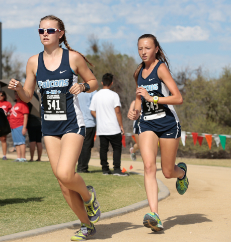 Foothill High School cross country team members Erica Schulz (541) and Erica Williams (545) make their way around the bend of the course during the 2016 Larry Burgess Cross Country Invitational he ...