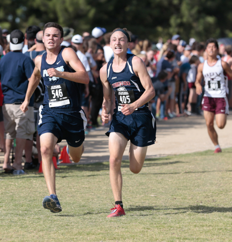 Foothill's Brian Coon (546), left, and Coronado's Tom Dougherty (405) show determination on their faces as they race towards the finish line of the varsity A boys race during the 2016 Larry Burges ...