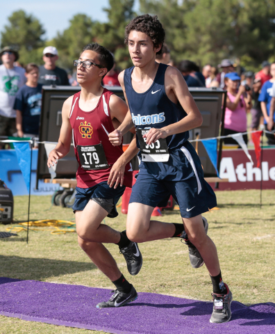 Cantwell-Sacred Heart's Markos Lemus (179), left, and Foothill's Joshua Wright (565) arrive at the varsity A boys finish line at the same time during the 2016 Larry Burgess Cross Country Invitatio ...