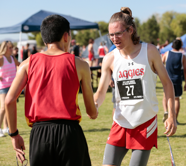 Arbor View junior and cross country runner Ian Jackson (27), right,  congratulates another runner after their race at the 2016 Larry Burgess Cross Country Invitational held at Sunset Park, 2601 Ea ...