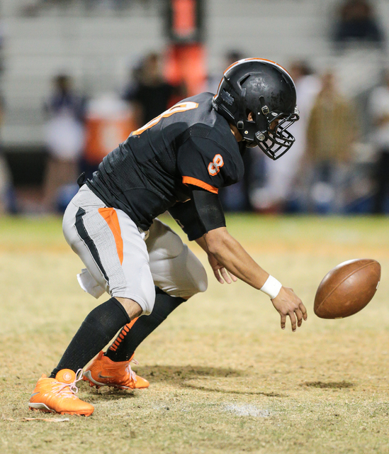Chaparral senior Santiago Vialpando (8) bobbles a hiked ball during a football game against Moapa Valley at Chaparral High School in Las Vegas, Friday, Oct. 21, 2016. Donavon Lockett/Las Vegas Rev ...