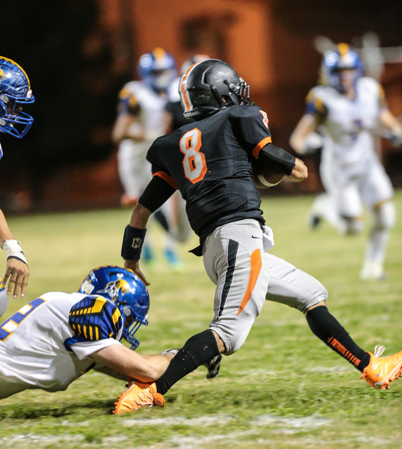 Chaparral  senior Santiago Vialpando (8) moves the ball down the field as Moapa Valley junior Brody Leavitt (42) try to tackle him during a football game held at Chaparral High School in Las Vegas ...