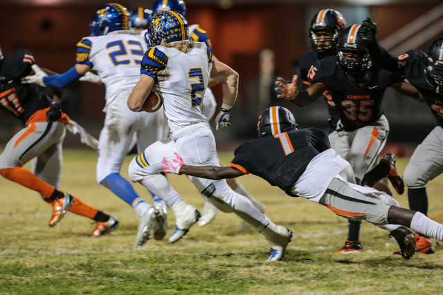 Chaparral  senior Christian Thomas-Fulton (1) , right, stretches out in an attempt to grab Moapa Valley senior Jacob Leavitt (2) during a football game at Chaparral High School in Las Vegas, Frida ...