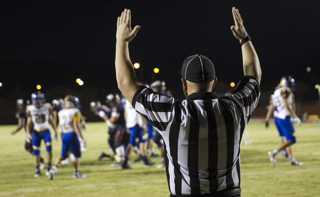 A referee calls a point during the Legacy High and Moapa Valley varsity football game at Legacy High School on Friday, Sept. 9, 2016. Richard Brian/Las Vegas Review-Journal Follow