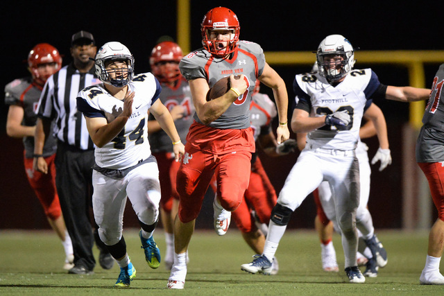 Arbor View quarterback Hayden Bollinger (18) runs the football during the Arbor View High School Foothill High School game at Arbor View in Las Vegas on Friday, Sept. 9, 2016. Brett Le Blanc/Las V ...