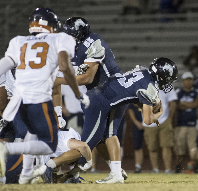 Quarterback Kody Presser (33) runs through the defensive line during a Legacy High School Shadow Ridge High School game at Legacy High School in North Las Vegas on Friday, Nov. 4, 2016 Loren Towns ...