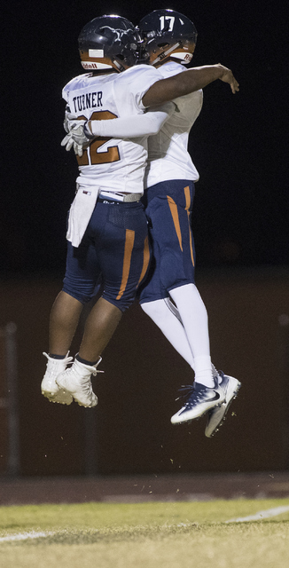 Legacy High School players Samuel Turner (22) and Davick Clark (17) celebrate a touchdown during a Legacy High School Shadow Ridge High School game at Legacy High School in North Las Vegas on Frid ...